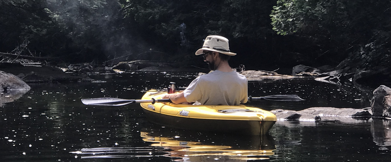 kayaker relaxing on a river