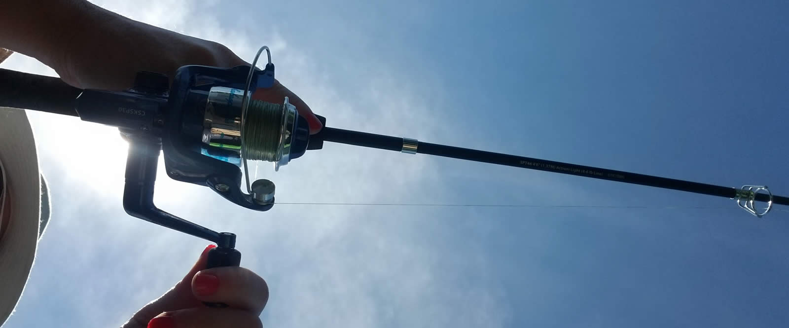 Fishing pole and blue sky in the background